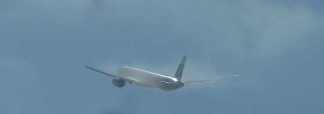 Cathay Pacific B-KTP Boeing 777-367ER jet climbs into the clouds above LAX