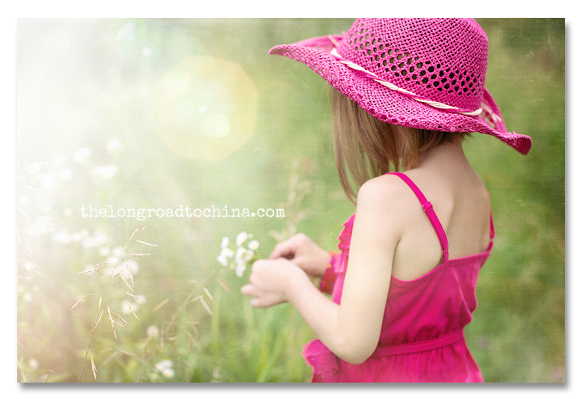 Sarah picking flowers in pink cowgirl hat2 BLOG