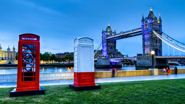 Decorated BT phone boxes and Tower Bridge early in the night.