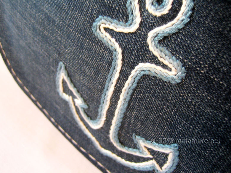 upcycled blue jeans clutch bag with hand embroidered anchor stem stitch
