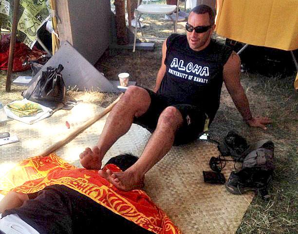 <p>Kapono Souza demonstrates lomi lomi at the Smithsonian Folklife Festival.</p>