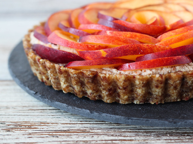 Raw nectarine and cardamom cream tart