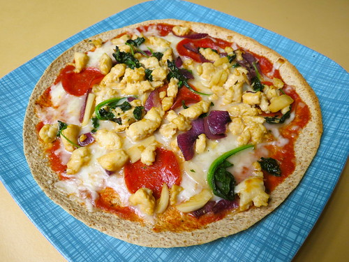 tortilla pizza with chicken sausage, turkey pepperoni, spinach, onion and garlic