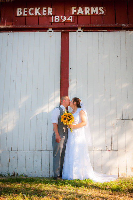 Megan And Justin Kiss Under Red Backer Farms