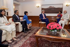 U.S. Secretary of State John Kerry, flanked by U.S. Commerce Secretary Penny Pritzker, U.S. Ambassador to India Richard Verma, and Assistant Secretary of State for South Central Asian Affairs Nisha Biswal, meets with Indian Prime Minister Narendra Modi on August 31, 2016, at the Prime Minister's Residence in New Delhi, India. [State Department Photo/ Public Domain]