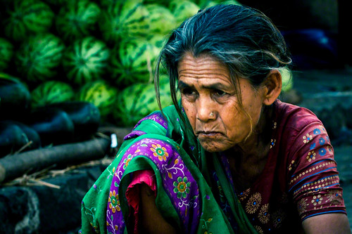 Indian elderly woman selling vegetables in an old market of Mumbai | India