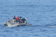 PACIFIC OCEAN (June 16, 2012) Sailors in a rigid-hull inflatable boat from the guided-missile cruiser USS Princeton (CG 59) retrieve 186 bales of marijuana, June 16, which were apparently destined for the United States. (U.S. Navy photo)