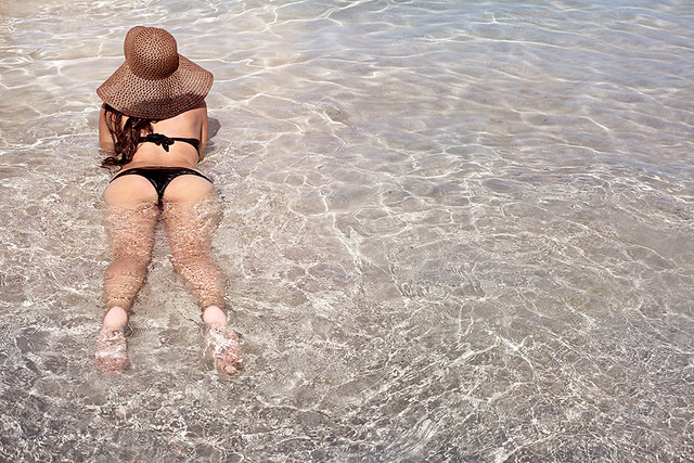Woman bathing in a clear water, sexy relax.