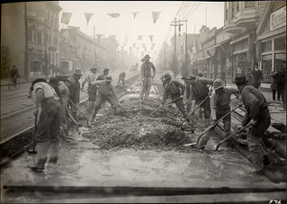 Workers paving and surfacing the road on Mission Street at 18th, December 9, 1910