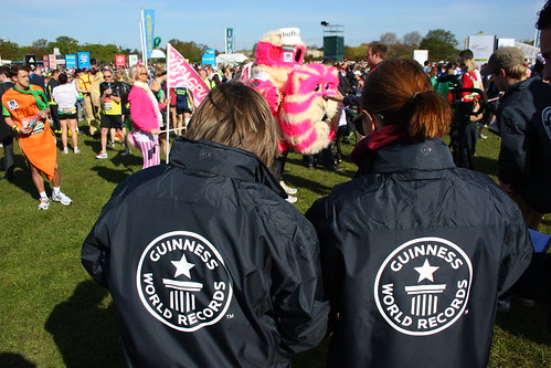 Guinness World Record adjudicators observe the many costumed runners