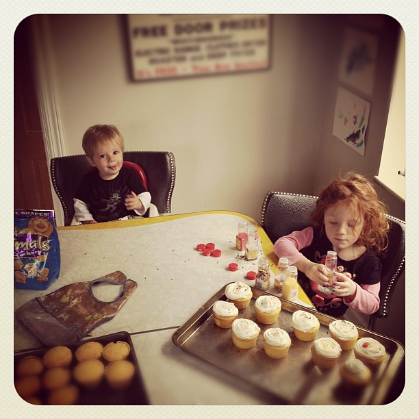 Frosting cupcakes.  #kids #cooking