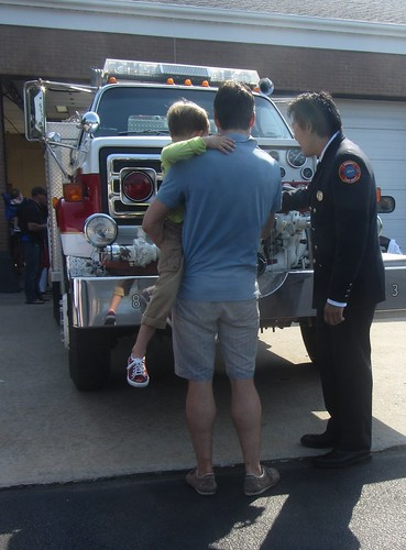 firefighter shows off the truck