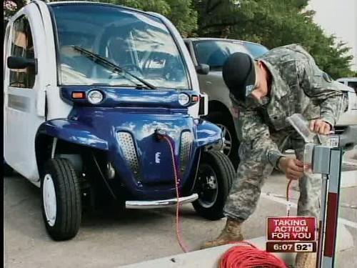 Soldier plugs in an energy-efficient vehicle (courtesy of WFTS-TV, ABC Action News)