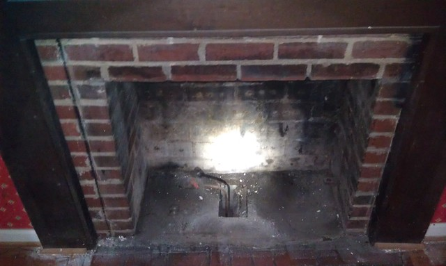 What is the ash pit in a fireplace for?
