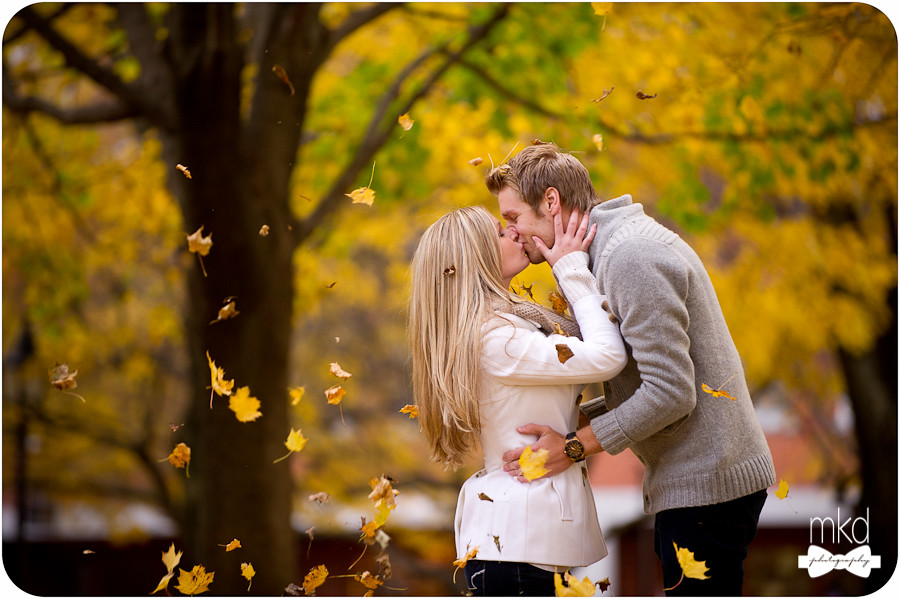Gorgeous couple kissing with the fall leaves