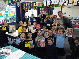 Year 4 of St Alban's Primary School with librarian Zac