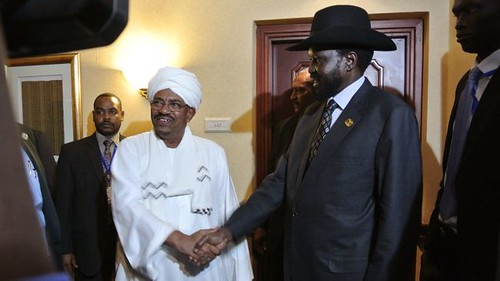 Presidents Omar Hassan al-Bashir of the Republic of Sudan and Silva Kiir of the Republic of South Sudan at a meeting during the African Union Summit in Addis Ababa, Ethiopia on July 14, 2012. The two Sudans have agreed to further talks. by Pan-African News Wire File Photos