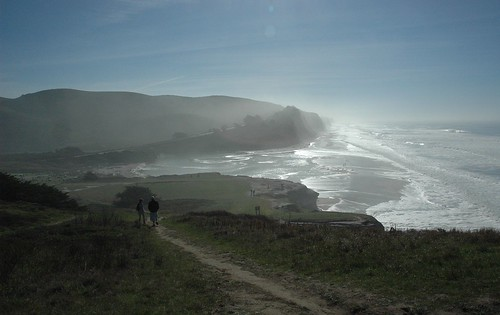 La Vette and Adam on the path over the wet, shining, beautiful edge of America, Pacific Coast, west coastal, California, USA by Wonderlane