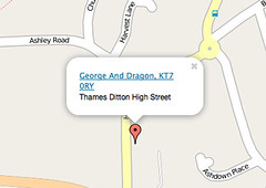 Screenshot of a small area of map showing a red pointer and a white info window reading 'George And Dragon, KT7 0RY, Thames Ditton High Street'.  The info window has a little triangle coming down from it and there is no gap between this triangle and the red pointer.