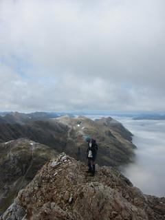 Andrew on the side of Tamatea Peak