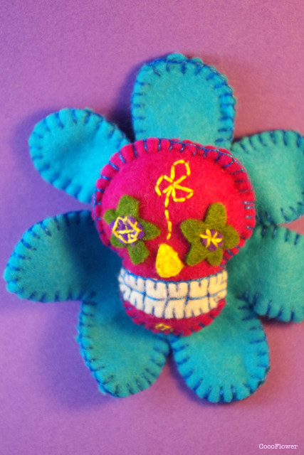 Flower skull brooch