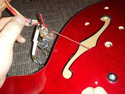 epiphone dot project ultimate guitar here i have cut the pickups off of the loom so what is this single red wire is it a ground it seems to go into the soundbox part of the guitar