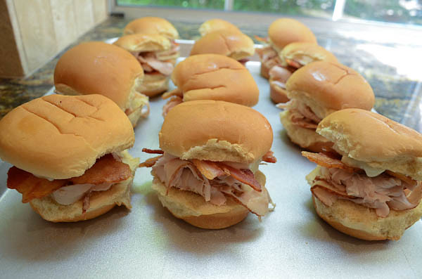 Several sliders arranged on a baking sheet.