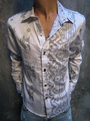 jacket(0.0), blouse(0.0), pattern(1.0), denim(1.0), textile(1.0), clothing(1.0), dress shirt(1.0), sleeve(1.0), outerwear(1.0), shirt(1.0),