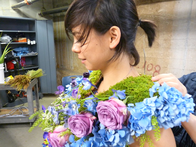 With flowers in place, Dextras makes further adjustments. Photo by April Greene.