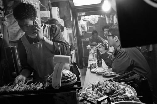 Cooking along the side streets of Shinjuku. Tokyo 2012