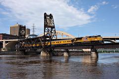 dredging(0.0), industry(0.0), barge(0.0), machine(1.0), water(1.0), vehicle(1.0), transport(1.0), river(1.0), public transport(1.0), locomotive(1.0), waterway(1.0), bridge(1.0),