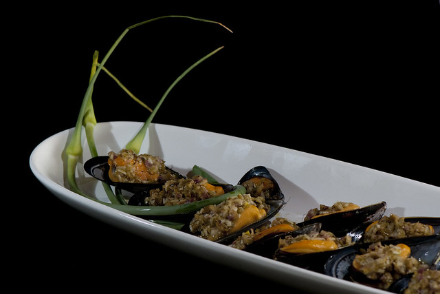 Mussels with grilled garlic scape pesto platter