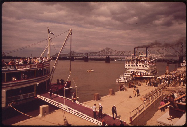 DOCUMERICA: Paddle wheel steamboats, docked at the new Louisville waterfront on the Ohio River, May 1972 by William Strode.