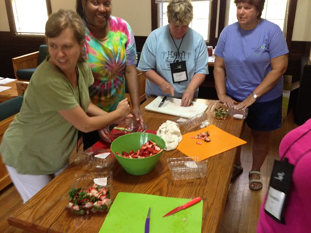 Last year's participants learn about canning and make strawberry jam.