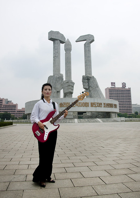 Young Woman Playing Bass On National Day On Square, Pyongyang North Korea