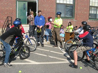 Bike Newton Certified Safety Instructor explaining helmet fit to youth
