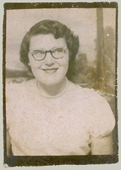 Photobooth girl with glasses and pearls