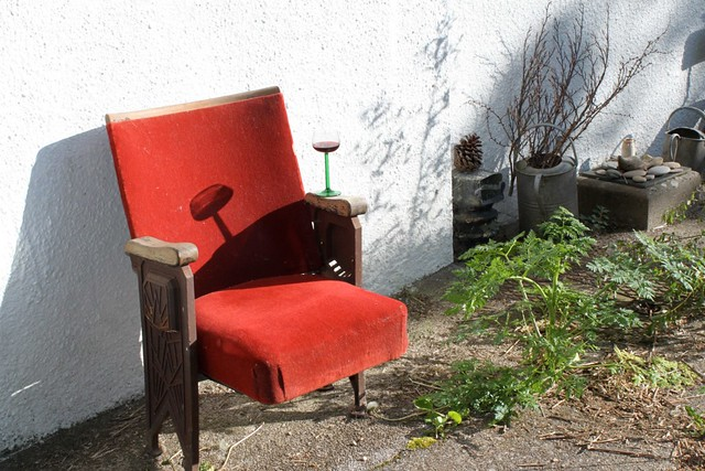 Old cinema chair set up for evening sun.