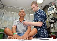 NORTH SALWESI, Indonesia (June 2, 2012) As part of in- processing aboard Military Sealift Command hospital ship USNS Mercy (T-AH 19), Hospitalman Steven Loll checks an Indonesian patient's heart rate in the Casualty Receiving Department during the Pacific Partnership 2012 mission.(U.S. Navy photo by Mass Communication Specialist 3rd Class Clay M. Whaley/Released)