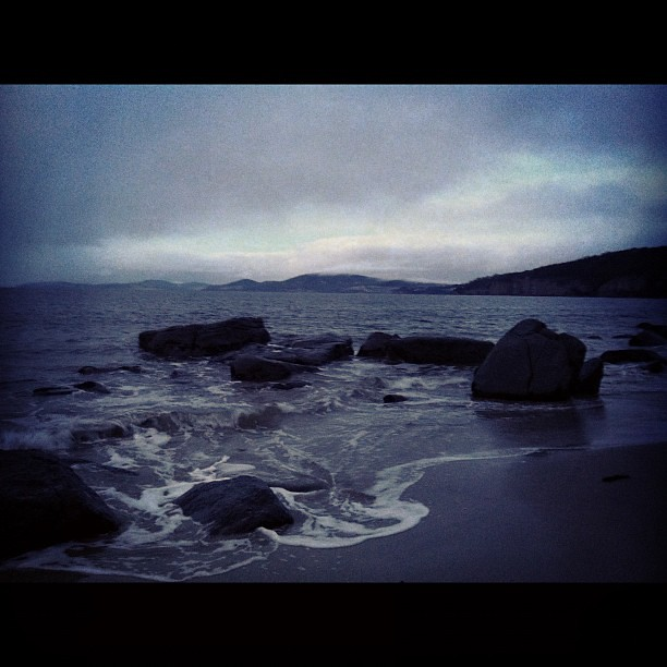 Dark, moody Winter morning... Sunrise on my walk. #winter #beach #tasmania
