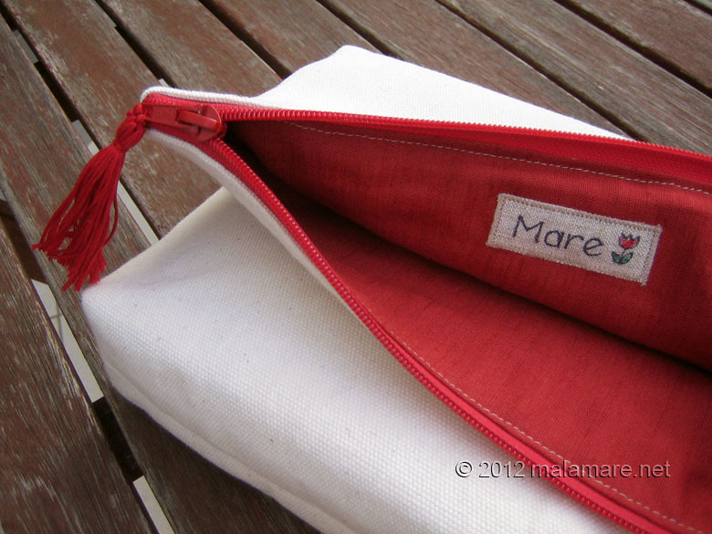 foldover cotton clutch with red hand embroidery inside