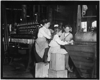 Daisy Langford, 8 years old, works on Ross's Canneries, Seaford, Del. She helps at the capping machine, but is not yet able to keep-up, June 1910