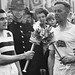Veteran runner H J Bignall (right) hands over the Olympic torch to Fred Prevett at Redhill, Surrey, during the flame's journey from Dover to Wembley Stadium, London, for the opening of the 1948 London Olympics ©ROH/2012