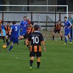 Lossiemouth captain Kevin Flett (5) takes a shot