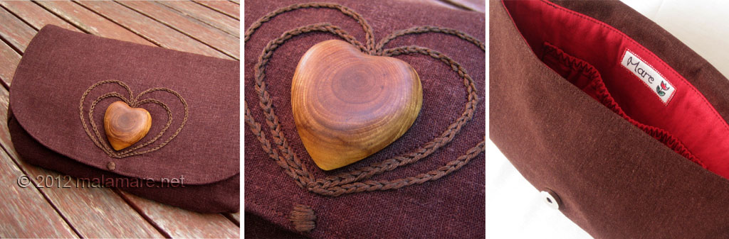 brown linen fabric clutch bag with olive wood heart and hand embroidered heart motif inside view and details