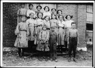 Young spinners in Elk Cotton Mills. Youngest girl hardly knew her name. Youngest boy runs two sides at ten cents each day. Fayetteville, Tenn, November 1910