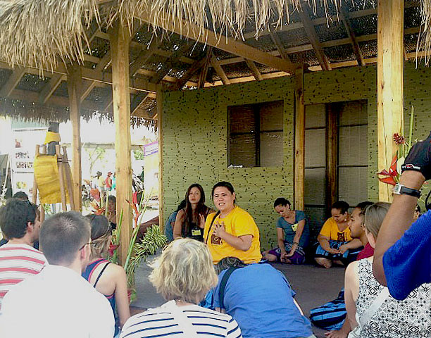 <p>Hawaii Community College's halau Unukupukupu talks to visitors at Aunty Noe's Porch t the Smithsonian Folklife Festival.</p>