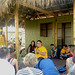 Hawaii Community College's halau Unukupukupu talks to visitors at Aunty Noe's Porch t the Smithsonian Folklife Festival.