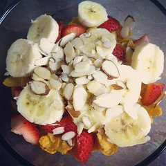 Corn flakes for breakfast again but this time I have strawberries, bananas, and almonds. My workout today was a yoga workout. Now I am going to make some coffee! #food #foodporn #breakfast #fruit