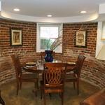 Dining area in exposed brick turret